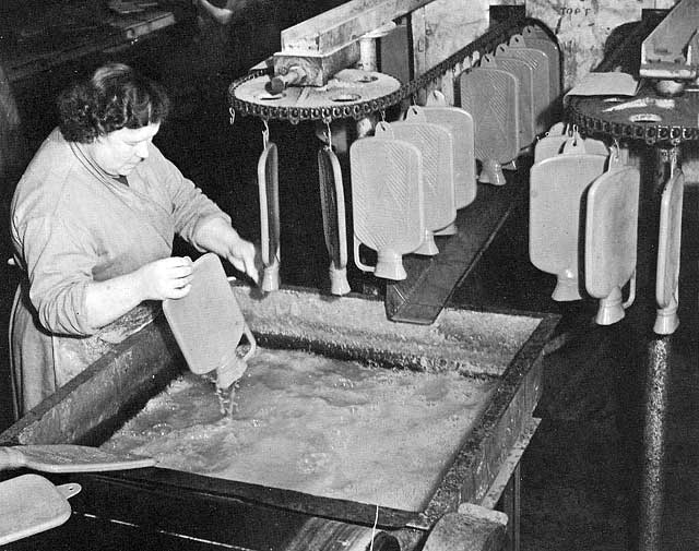 Hot water bottles in production, 1900
