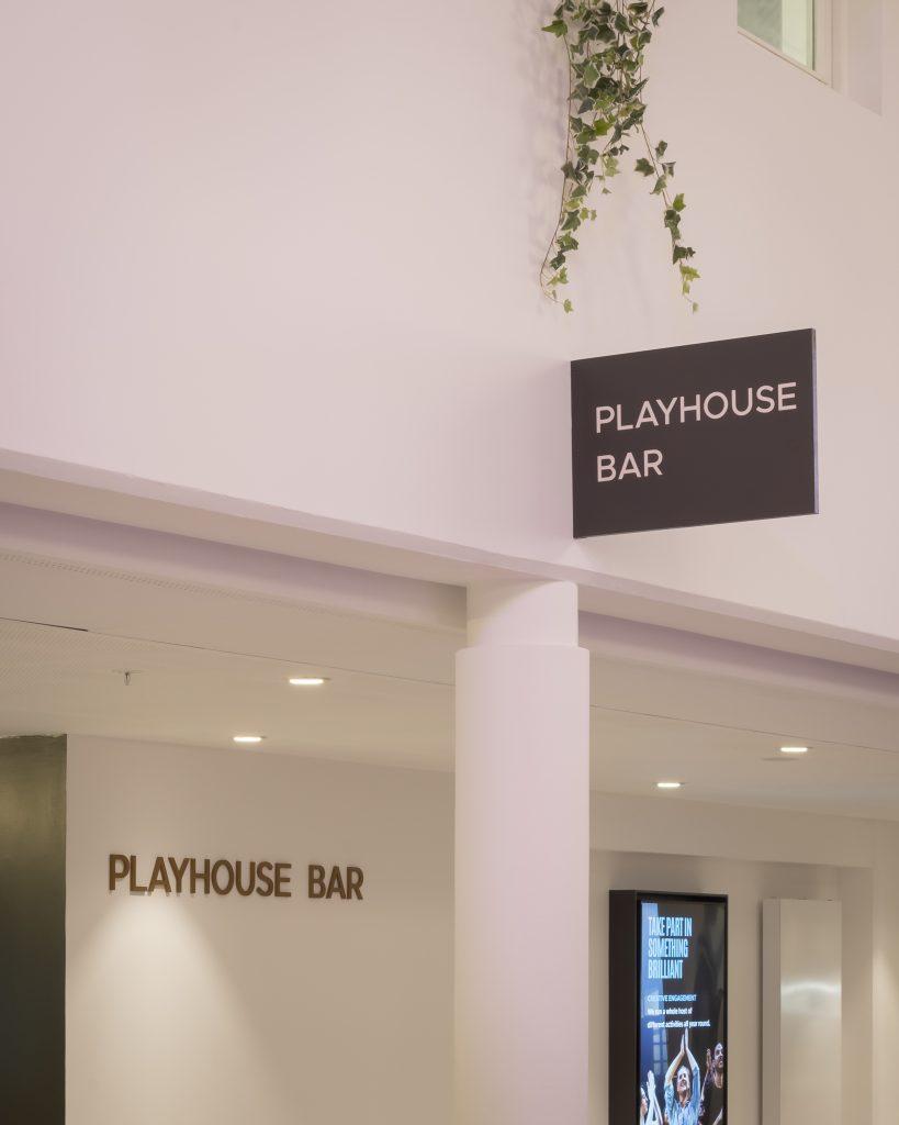 Signage at Playhouse Bar
