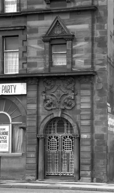 Entrance to the bank with metal gate detailing