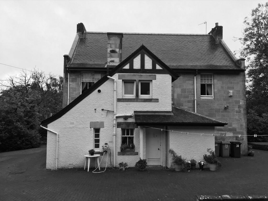 The rear of the existing manse has been a source of inspiration for asymmetric roof profiles, creating a shared language that references the arts and crafts style of the building